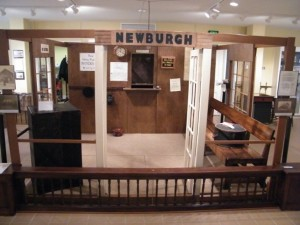The ticket window and Louisville and Nashville calendar are almost identical to what is seen in a vintage photograph of Newburgh's E&OV depot